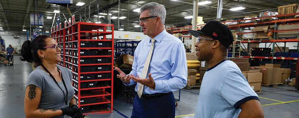 Chairman, CEO and President Ray Chambers talks with employees at the Tulsa division of Muncie Power Products